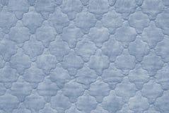 蓝色床罩 免版税库存照片