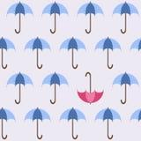 蓝色开放伞和一红色一个您的设计的 免版税库存照片