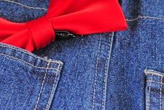 蓝色弓牛仔裤关系 免版税库存图片