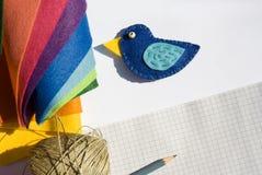 蓝色手工制造鸟 库存图片