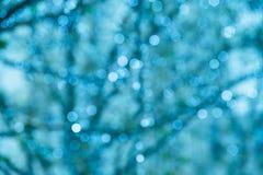 蓝色扭转的闪闪发光背景 库存图片