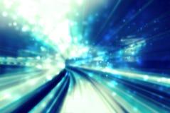 蓝色抽象发光的轻的未来派路 免版税库存图片