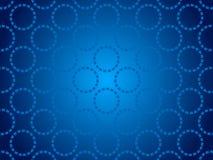 蓝色抽象背景,微粒圈子 图库摄影