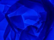 蓝色抽象背景-纸上升了,玫瑰华饰 库存照片