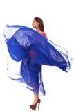 蓝色挥动的飞行礼服的美丽的妇女 库存图片