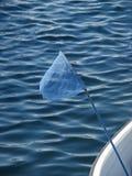 蓝色捕鱼网起波纹海运 免版税库存照片