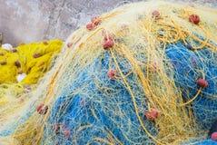 蓝色捕鱼网黄色 免版税库存图片