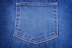 蓝色接近的牛仔裤装在口袋里  免版税库存图片