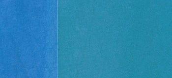 蓝色操场或运动场橡胶面包屑盖子难看的东西背景 图库摄影