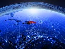 蓝色数字行星地球上的多米尼加共和国与代表通信、旅行和连接的国际网络 3d 免版税库存照片