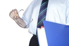 蓝色文件夹在手中 免版税图库摄影