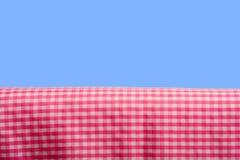 蓝色方格花布粉红色天空 图库摄影