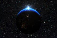 蓝色日出,地球看法从空间的 免版税图库摄影