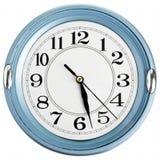 蓝色时钟墙壁 免版税库存图片