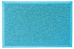 蓝色有拷贝空间的纤维门垫 免版税库存照片