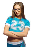 蓝色服装的年轻运动的女孩 免版税库存照片
