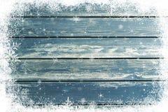 蓝色木纹理有圣诞节雪作用背景 免版税库存照片