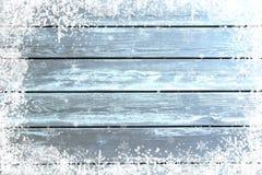 蓝色木纹理有圣诞节雪作用背景 免版税图库摄影