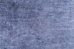 蓝色条绒裤子 免版税库存照片