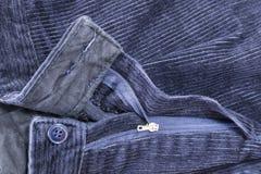 蓝色条绒裤子 免版税库存图片