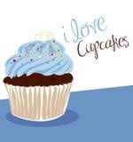 蓝色杯形蛋糕光 图库摄影
