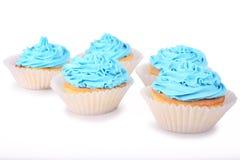 蓝色杯形蛋糕 免版税库存照片