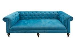 蓝色查出的沙发 免版税库存照片