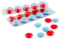 蓝色查出的红色片剂 免版税库存图片