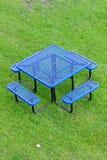 蓝色桌和椅子在草原 免版税图库摄影