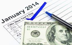 蓝色检查。在日历的标记在2014年1月1日与usd m 免版税库存图片