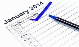 蓝色检查。在日历的标记在2014年1月1日,新年的 库存照片