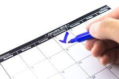 蓝色检查。在日历的标记在2014年1月1日 免版税图库摄影