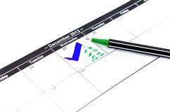 蓝色检查。在日历的标记在2013年12月25日 库存图片