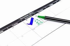 蓝色检查。在日历的标记在2013年12月25日 图库摄影