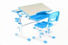 蓝色椅子和学校书桌 库存图片