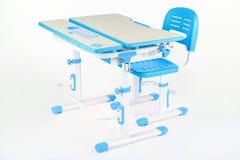 蓝色椅子和学校书桌 图库摄影