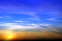 蓝色橙色日落 免版税库存照片