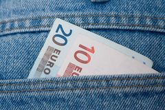 蓝色欧元牛仔裤 免版税库存照片