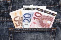 蓝色欧洲牛仔裤货币矿穴 库存照片
