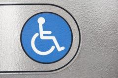 蓝色残疾符号 免版税库存图片