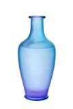 蓝色毛玻璃查出的紫色花瓶 图库摄影