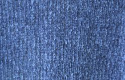 蓝色毛线衣织品纹理和背景 库存图片