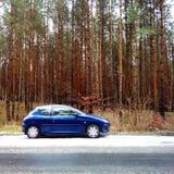 蓝色汽车一点 库存照片