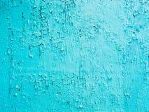 蓝色油漆背景脏破裂和切削 库存照片