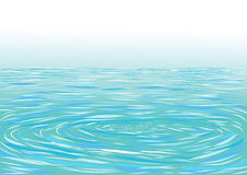 蓝色波纹水表面 免版税库存图片