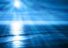 蓝色海洋平安的日落 免版税库存照片