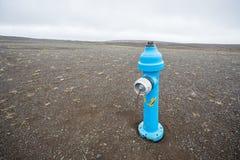 蓝色消防栓 免版税库存照片