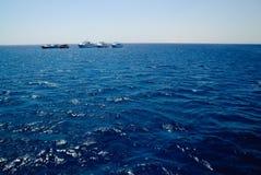 蓝色深深四条海运游艇 库存照片