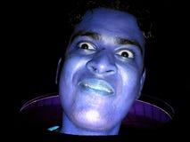 蓝色滑稽的人 库存照片