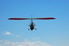 蓝色滑翔机动力化的天空 免版税图库摄影
